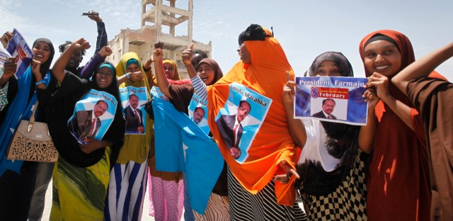 Somalis celebrate and hold banners of newly elected Somali President Mohamed Abdullahi Farmajo in the capital Mogadishu, Somalia Thursday, Feb. 9, 2017. Former prime minister Farmajo who holds dual Somali-U.S. citizenship was declared Somalia's new president Wednesday, immediately taking the oath of office as the long-chaotic country moved toward its first fully functioning central government in a quarter-century.