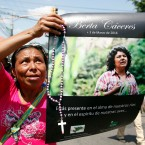 "A woman holds up a poster with a photo of slain environmental leader Berta Caceres, during a protest march in Tegucigalpa, Honduras, Wednesday, March 16, 2016. Authorities said that unidentified gunmen killed Nelson Garcia, a colleague of Caceres, who was slain almost two weeks ago in similar circumstances. The organization that both Caceres and Garcia belonged to is describing Garcia's death as part of ""the government's constant harassment"" of Indian groups. Both activists were Lenca Indians and belonged to the Indian Council of People's Organizations of Honduras."