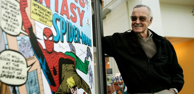 Comic book creator Stan Lee stands beside some of his drawings in the Marvel Super Heroes Science Exhibition at the California Science Center in Los Angeles Tuesday, March 21, 2006.