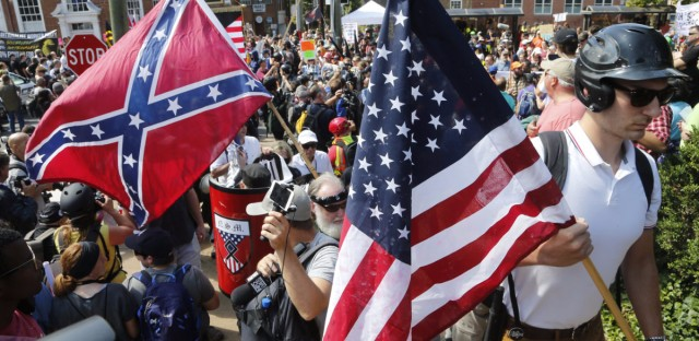 White nationalist demonstrators walk into a park to protest the pending removal of a statue of Confederate Gen. Robert E. Lee in Charlottesville, Va., this weekend.