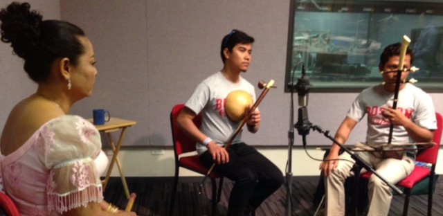 Playing live in the WBEZ studios (from left): Yim Chan thy, playing woodwinds; Lun Phanith, playing the Kse diev, a single string instrument with a gord; Nhouk Sinat, playing the stringed instrument like an upright fiddle called the t'ro.