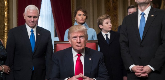 President Donald Trump is joined by the Congressional leadership and his family before formally signing his cabinet nominations into law, Friday, Jan. 20, 2107, in the President's Room of the Senate on Capitol Hill in Washington. From left are, Vice President Mike Pence, the president's wife Melania Trump, their son Barron Trump, and House Speaker Paul Ryan of Wis.