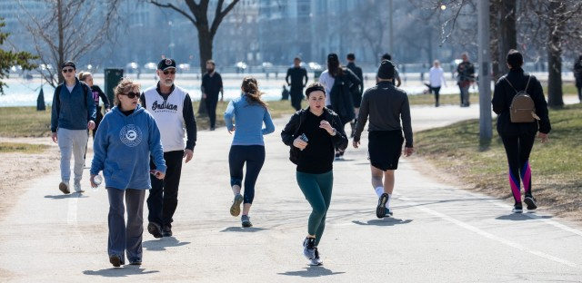 People run along the Lakefront Trail in Chicago