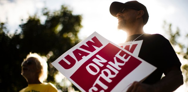 Union members picket outside a General Motors facility in Langhorne, Pa., Monday, Sept. 16, 2019.