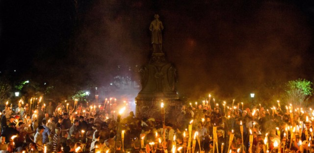 Neo-Nazis, white supremacists and other demonstrators encircle counter-protesters at the base of a statue of Thomas Jefferson in Charlottesville, Va., on Friday.