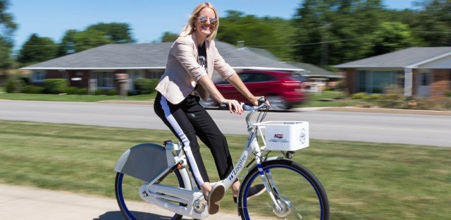 Staci Wilken, executive director of the Kankakee County Convention and Visitors' Bureau, rides one of the bikes in Kankakee County's new bike-share program. Wilken stopped by the Morning Shift on Monday to talk with Tony Sarabia about the program.