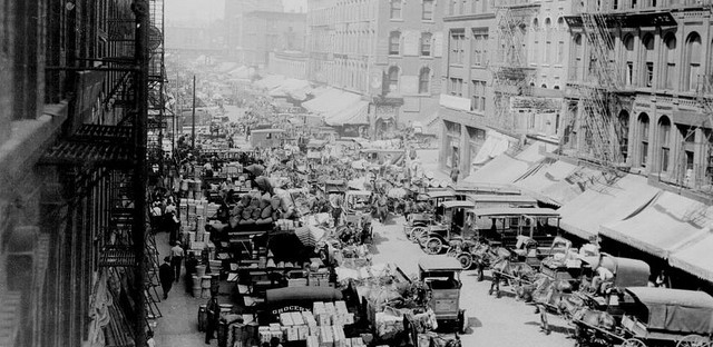 Looking west on South Water Street, Chicago, crowded with horse-drawn wagons and motor trucks filled with produce for market, April 1915.