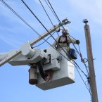 "Eric Elder, an Army reservist who came to Puerto Rico in early October to do power line work, says the work is challenging. ""Every pole is different, every pole has to be looked at and dressed differently."""