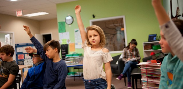 A student raises her hand during the morning meeting at Greenfields Academy in Chicago.