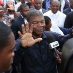 In this Wednesday, Aug. 23, 2017 file photo Joao Lourenco, shows his ink-stained finger as he faces the media after casting his vote in elections in Luanda, Angola, Angola's election commission announced Friday Aug. 25, 2017