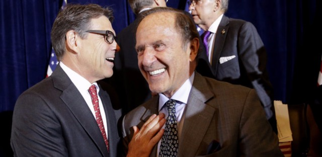 In a photo from 2015, then-Republican presidential candidate, former Texas Gov. Rick Perry, greets New York Daily News publisher Mortimer Zuckerman during a luncheon hosted by the Committee to Unleash Prosperity, at the the Yale Club in New York. (Mary Altaffer/AP)