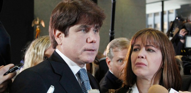 In this Dec. 7, 2011 file photo, former Illinois Gov. Rod Blagojevich, left, speaks to reporters as his wife, Patti, listens at the federal building in Chicago.