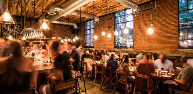 Rolf and Daughters, in Nashville, Tenn., boasts exposed brick, bare bulbs and ceiling pipes.