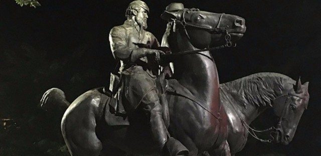 "Workers load a statue of Confederate Gens. Robert E. Lee and Thomas ""Stonewall"" Jackson on a flatbed truck in the early hours of Wednesday in Baltimore. A campaign to remove symbols of the Civil War-era, pro-slavery secessionist republic is gathering momentum across the United States. Alec MacGillis/AFP/Getty Images"