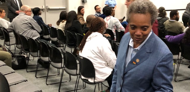 Chicago Mayor Lori Lightfoot greets an attendee at a Chicago Police Board meeting in June, 2019. Lightfoot used to head the police accountability panel.