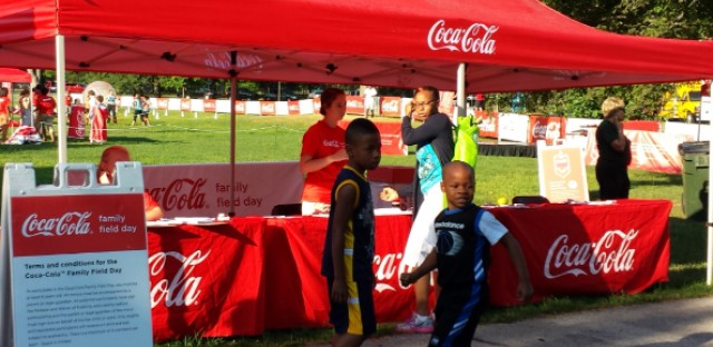 Kids at a Coca-Cola sponsored event.