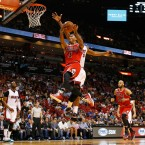 Chicago Bulls Derrick Rose (1) goes past Miami Heat's Amar'e Stoudemire (5) as he goes to the basket during the first half of an NBA basketball game in Miami.