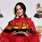 Kacey Musgraves holds the four Grammys she won Sunday night.