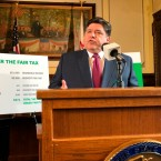Gov. JB Pritzker outlines his plan to replace Illinois' flat-rate income tax with a graduated structure at a state Capitol news conference on Thursday, March 7, 2019 in Springfield, Ill.