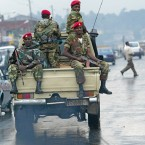 n this June 10, 2005 file photo, members of the Ethiopian army patrol the streets of Addis Ababa, Ethiopia, after recent clashes with protesters. Violent weekend clashes between protesters and security forces have claimed the lives of more than a dozen people across Ethiopia. The government announced Sunday, Aug. 7, 2016 that seven protesters died in the northern Amhara region's capital, Bahir Dar. Witnesses who spoke to The Associated Press anonymously for fear of reprisals said anti-riot police also used force Saturday to disperse hundreds of protesters in the capital, Addis Ababa.