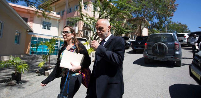 Oxfam International Regional Director for Latin America Simon Ticehurst, right, leaves with Oxfam Intermon Executive Affiliate Unit head, Margalida Massot after a meeting with Haiti's Minister of Planning and External Cooperation Aviol Fleurant in Port-au-Prince, Haiti, Thursday Feb. 22, 2018. Fleurant says Oxfam will be suspended in the country for two months pending an investigation into sexual misconduct by employees of the aid group. (