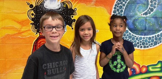 First graders Sam, Harriet and Christina were among Evanston's Dewey Elementary students who shared advice for kids just starting school.
