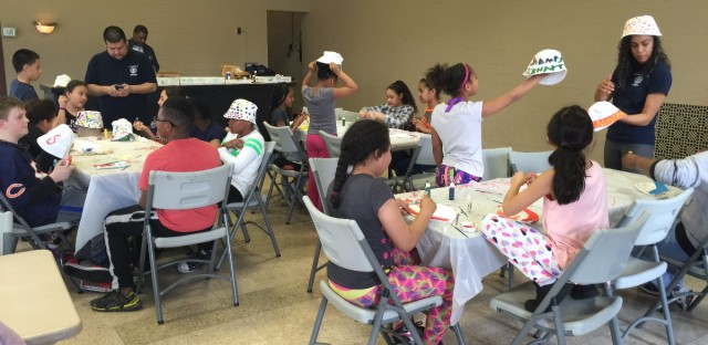 Students from all over Chicago paint canvas hats at Eckhart Park Fieldhouse on the Northwest Side. The fieldhouse was one of the contingency centers set up by CPS during the CTU one-day strike.