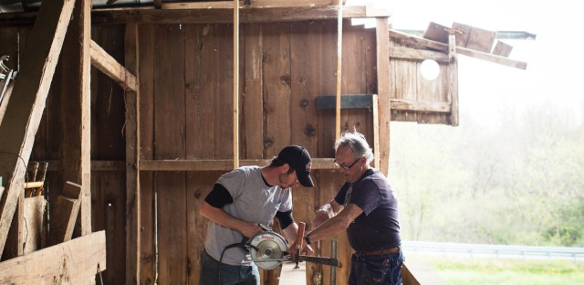 Charles Testerman (left) learns from David Gibney how to restore an early 19th century barn in Waynesboro, Pa.