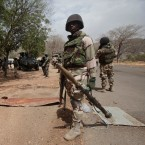 In this Wednesday April 8, 2015 file photo, Nigerian soldiers man a checkpoint in Gwoza, Nigeria, a town newly liberated from Boko Haram. Nigeria's president has exaggerated the military's success against Boko Haram, say officials in northern Nigeria in response to an American commander's testimony that the Islamic extremist group still holds territory.