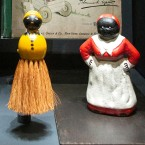 Wide-mouthed blackface figures of Uncle Tom and postcards of eating watermelon perpetuated negative stereotypes about African-Americans. The minstrel caricatures showed up on toys, games, books, postcards and everyday household items.