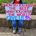 Amy Pricer, a Social Studies Teacher at Keyser High School, holds a sign at a teacher rally at the West Virginia Capitol in Charleston, W.Va.