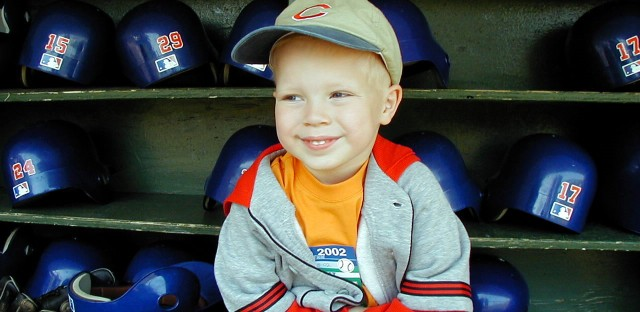 Cheryl Raye Stout's son, Jaxon, in the Cubs dugout in 2002.