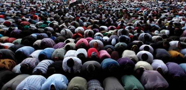 Egyptian Muslim Brotherhood supporters attend prayers during an anti ruling military council demonstration in Tahrir Square, Cairo, Egypt Tuesday, June 19, 2012.