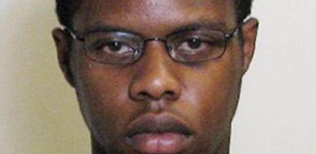 This undated photo provided by the Madison County Sheriff's Office shows Keaun L. Cook of Godfrey, Illinois. Madison County State's Attorney Tom Gibbons said on Sept. 1, 2016 that Cook was charged with material support for terrorism and making a terrorist threat. Gibbons said the threats were verbal and that Cook had been in contact with a terrorist organization via multiple electronic means.
