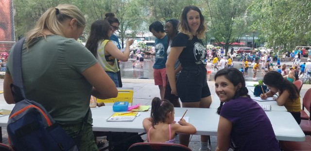 Kaylyn Carter and Mary Tilden teaching at free creative writing workshop held by the arts education nonprofit Barrel of Monkeys at the Millennium Park on August 6, 2019.