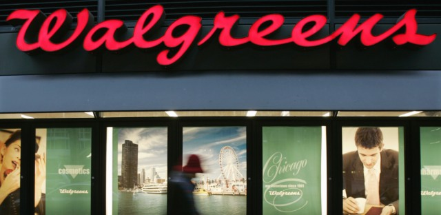 A pedestrian walks past a Walgreens drugstore in the west Loop area of downtown Chicago on Tuesday, Jan. 3, 2006.