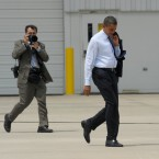 President Barack Obama walks to Air Force One in Grand Rapids, Mich. in July 2010, with White House photographer Pete Souza