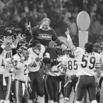 In this Jan. 26, 1986, file photo, Chicago Bears defensive coordinator Buddy Ryan is carried off the field by the team after the Bears beat the New England Patriots 46-10 in Super Bowl XX in New Orleans. Buddy Ryan, who coached two defenses that won Super Bowl titles and whose twin sons Rex and Rob have been successful NFL coaches, died Tuesday, June 28, 2016. He was 82.