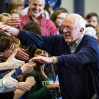 Sen. Bernie Sanders shakes hands with audience members after speaking at a campaign rally in Portsmouth, N.H.