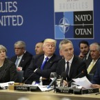British Prime Minister Theresa May, U.S. President Donald Trump and NATO Secretary General Jens Stoltenberg listen to Belgian Prime Minister Charles Michel as he speaks during a working dinner meeting at the NATO headquarters during a NATO summit of heads of state and government in Brussels on May 25, 2017.