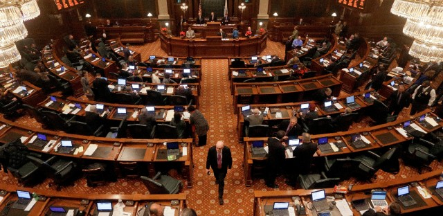 Illinois Rep. Greg Harris, D-Chicago, walks down the center aisle of the House chambers during veto session at the Illinois State Capitol Thursday, Dec. 1, 2016, in Springfield, Ill.