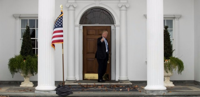 President Trump heads back inside the Trump National Golf Club clubhouse in Bedminster, N.J.