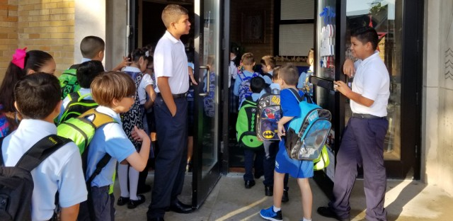 Students file into St. Mary Star of the Sea school on Chicago's Southwest Side