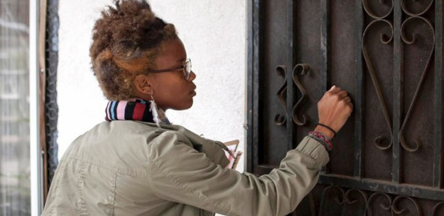 A canvasser knocks on a door in Los Angeles.