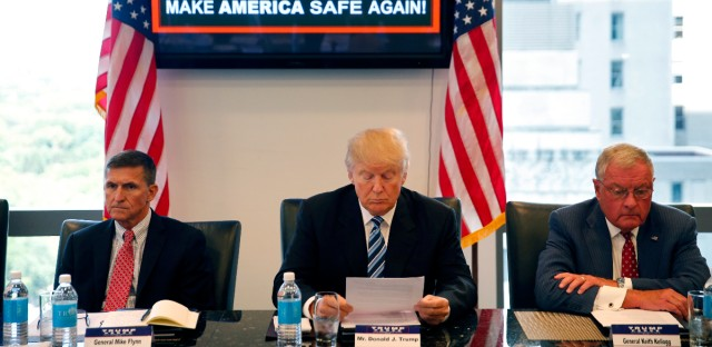 In this Aug. 17, 2016 photo, then-Republican presidential candidate Donald Trump participates in a roundtable discussion on national security in his offices in Trump Tower in New York, with Ret. Army Gen. Mike Flynn, left, Ret. Army Lt. Gen. Keith Kellogg.