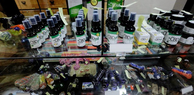 In this Oct. 20, 2015 photo, products for use with marijuana are available inside of Salveo Health and Wellness, a licensed medical cannabis dispensary, in Canton, Ill. Illinois will begin its first medical marijuana sales within the next two weeks. (AP Photo/Seth Perlman)
