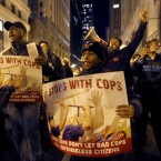 Protesters march through Chicago's Loop calling for Chicago Mayor Rahm Emanuel and Cook County State's Attorney Anita Alvarez to resign in the wake of a police scandal, Thursday, Dec. 10, 2015, in Chicago.