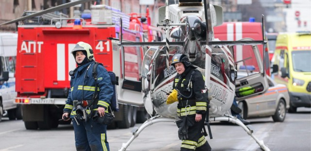 Rescue workers near the scene of the explosion Monday in St. Petersburg, Russia.