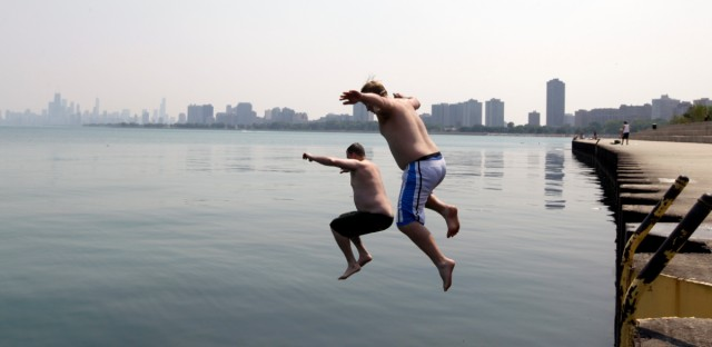 Two men jump into Lake Michigan at Montrose Beach during a Chicago heat wave in 2012.