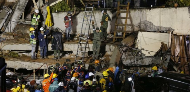 Rescue personnel work at the scene of Enrique Rebsamen School, which collapsed when an earthquake struck on Tuesday. Workers have been able to communicate with a girl who's alive — but trapped in the rubble.